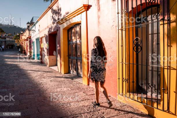 Young Woman Walking The Streets Of Oaxaca City Stock Photo - Download Image Now