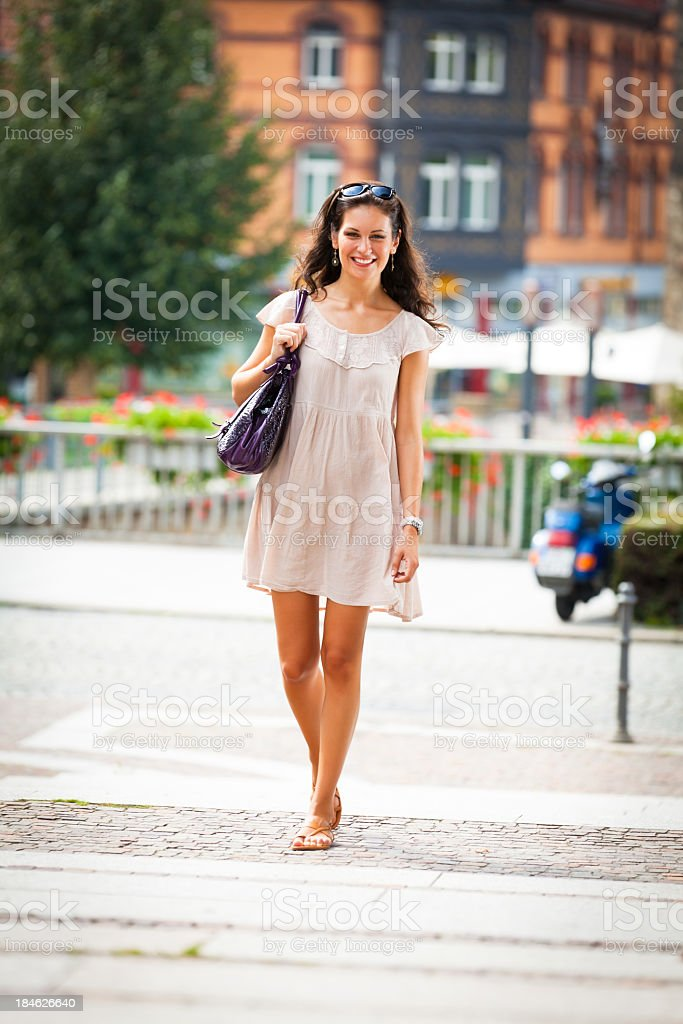 young woman walking through the city of esslingen stock photo