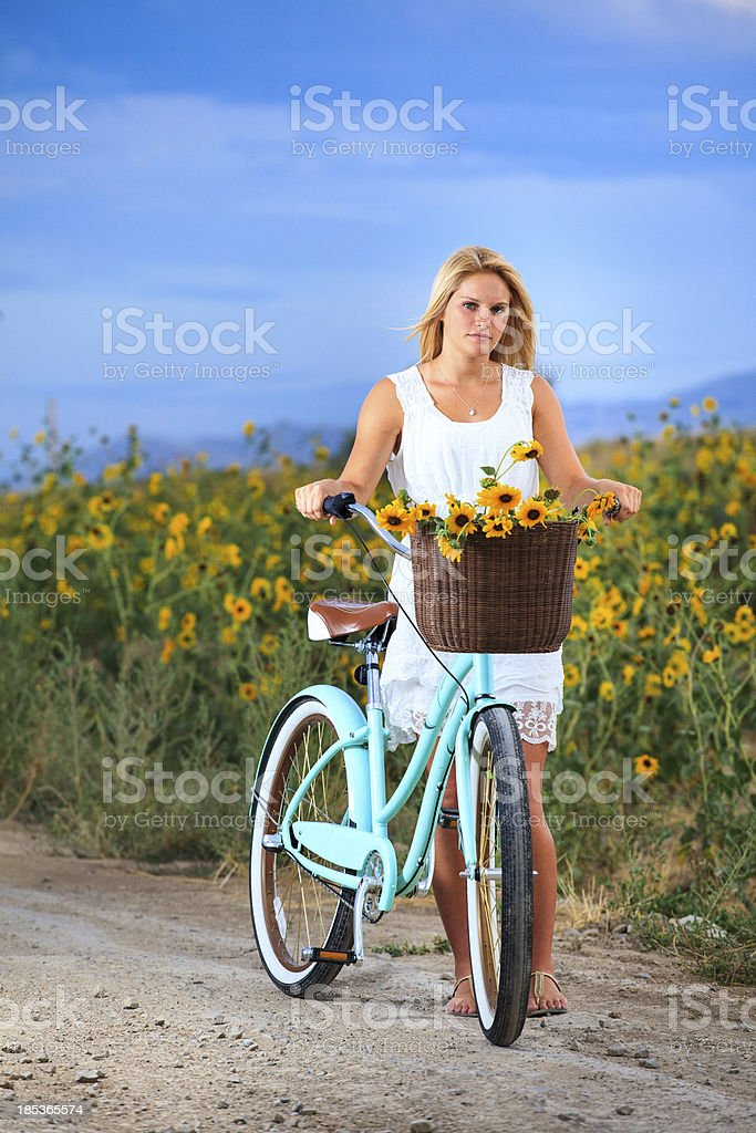 Young woman walking with a bike stock photo