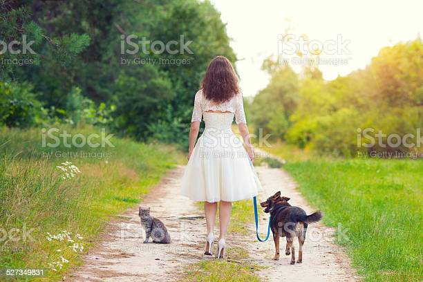 Young woman walking with dog and cat picture id527349831?b=1&k=6&m=527349831&s=612x612&h= dwlncmyqigxviu9ujixw0uhorf3lgxdvkegibfep6g=