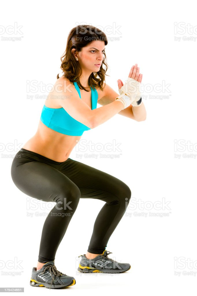Young woman warming up for body combat fitness royalty-free stock photo