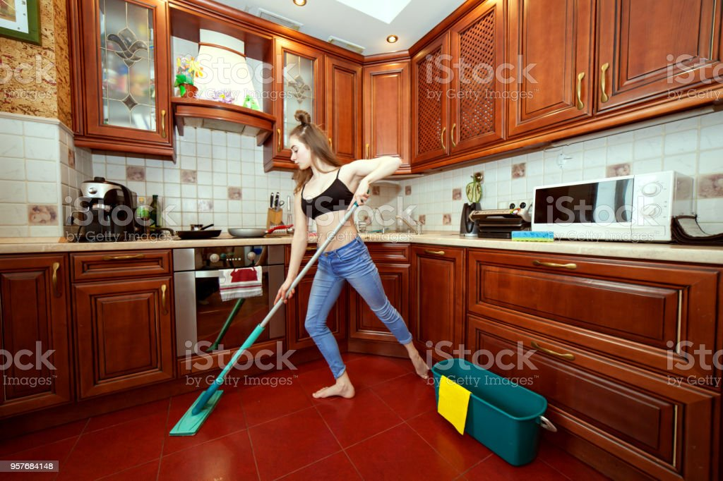 Young woman washes the floors. stock photo