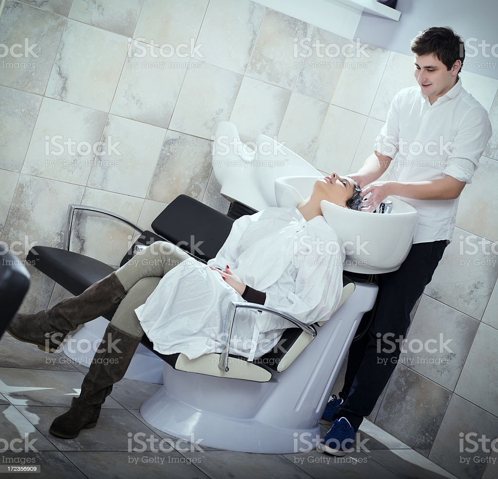 Young woman washing hair in salon royalty-free stock photo