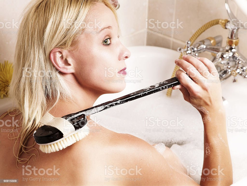Young woman washing her back royalty-free stock photo