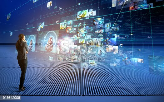 istock Young woman watching holographic vision. 913642008