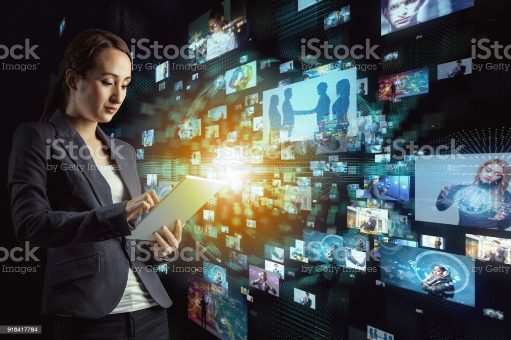 Young woman watching many pictures with tablet PC. stock photo