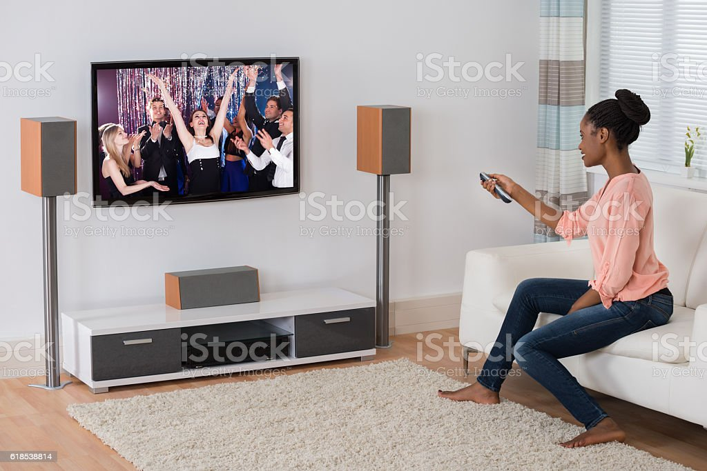 Young Woman Watching Movie stock photo