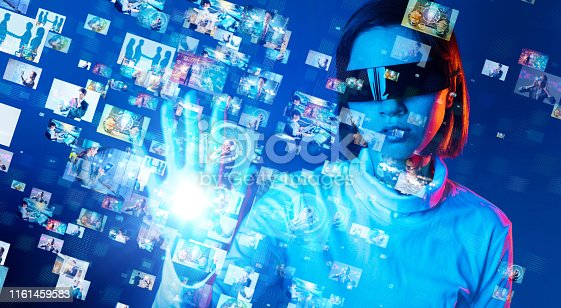 693586040istockphoto Young woman watching stereoscopic screens. Graphical User Interface. 1161459583