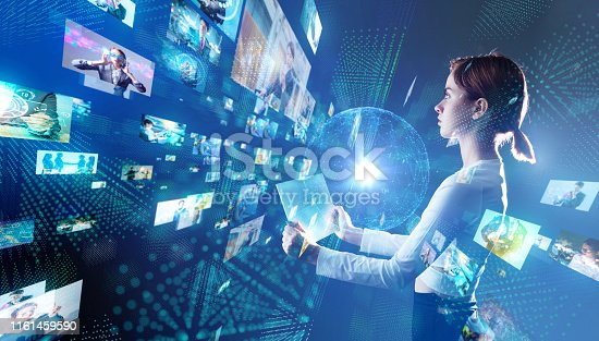istock Young woman watching stereoscopic screens. Graphical User Interface. 1161459590