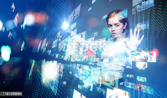 693586040istockphoto Young woman watching stereoscopic screens. Graphical User Interface. 1161459594