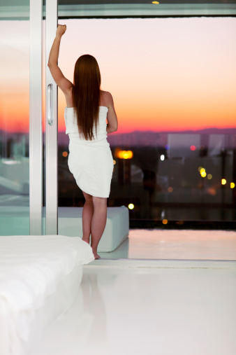 istock Young Woman Watching Sunset 184613542
