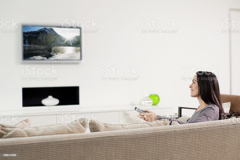 Young woman watching television royalty-free stock photo