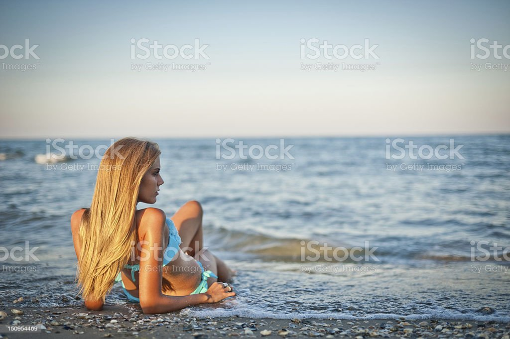 Young woman watching the sea royalty-free stock photo