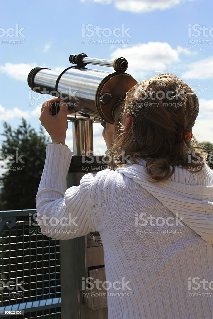 Young woman watching through periscope royalty-free stock photo