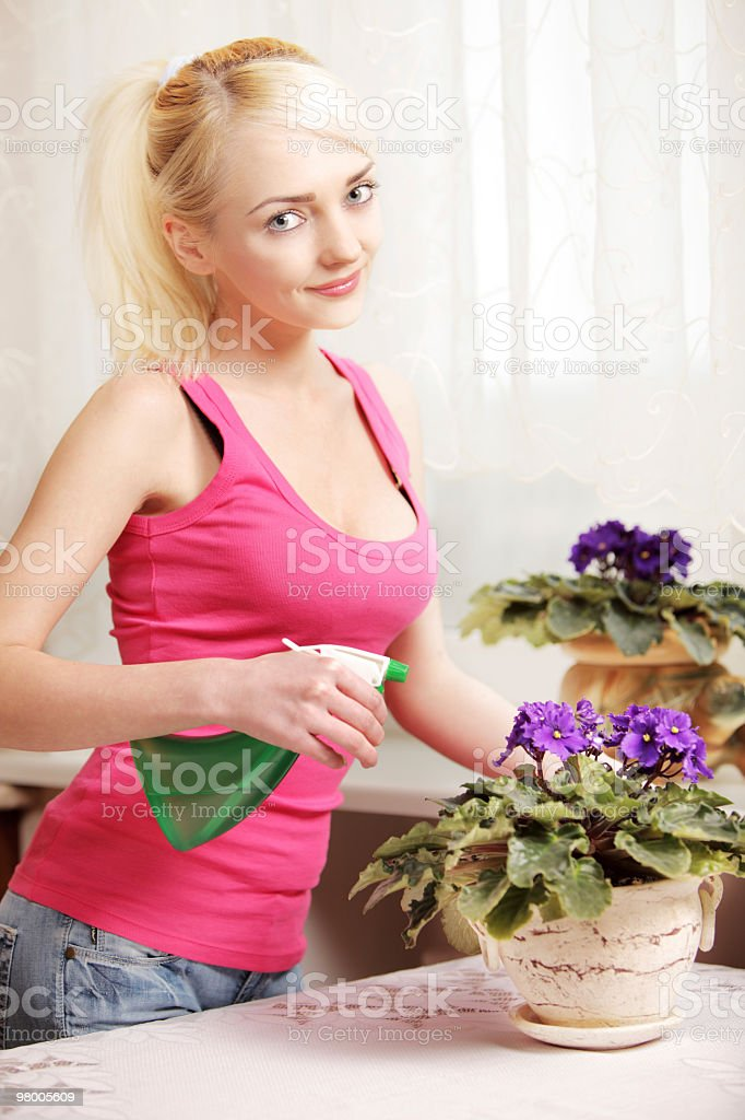 young woman watering flowers royalty-free stock photo