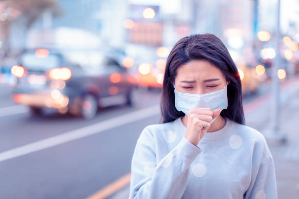 young  woman wear mask in the city during smog day - virus stock pictures, royalty-free photos & images