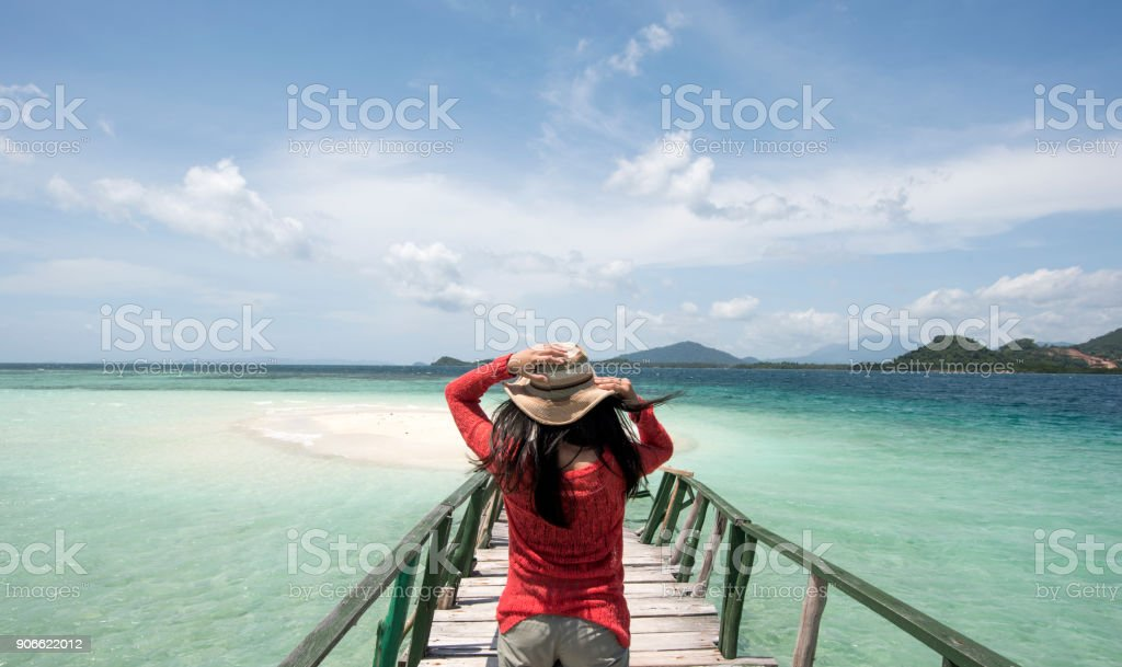 Young Woman Wear Red Shirt At Beach stock photo