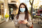 istock Young woman wearing a face mask 1217466536
