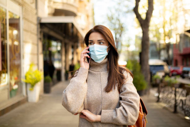 Young woman wearing a face mask stock photo