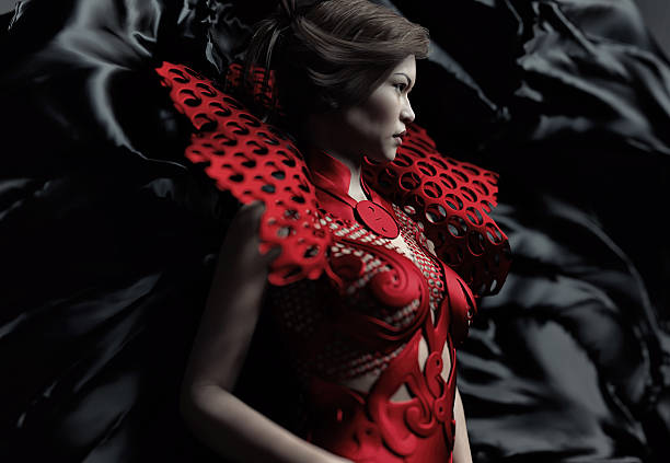 young woman wearing a gothic red dress - gothic fashion stock photos and pictures