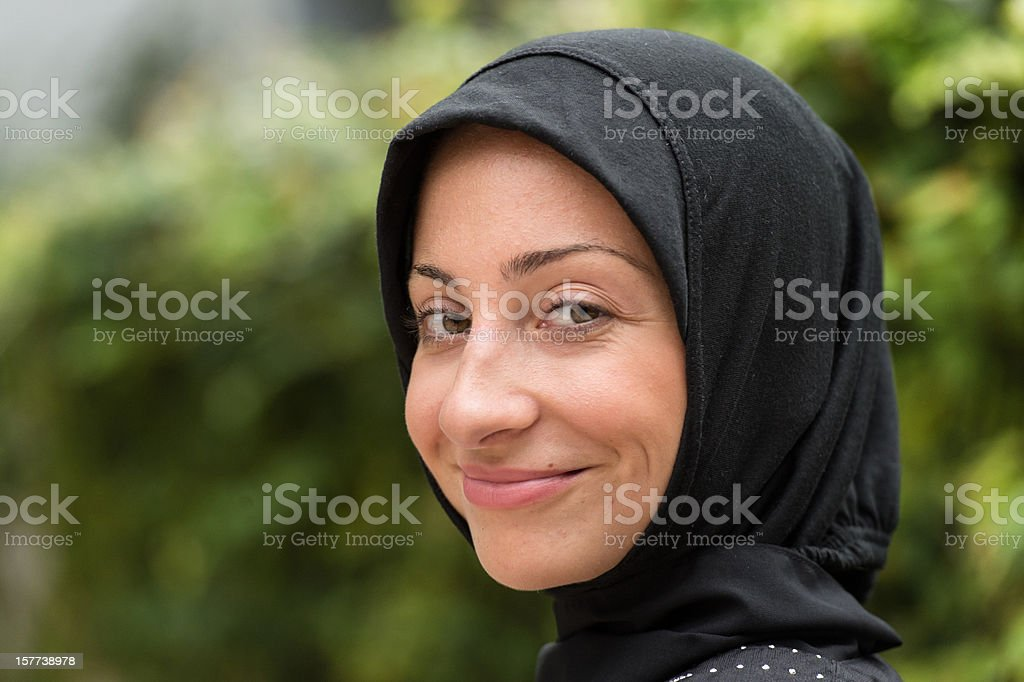 Young woman wearing a headscarf smiling stock photo
