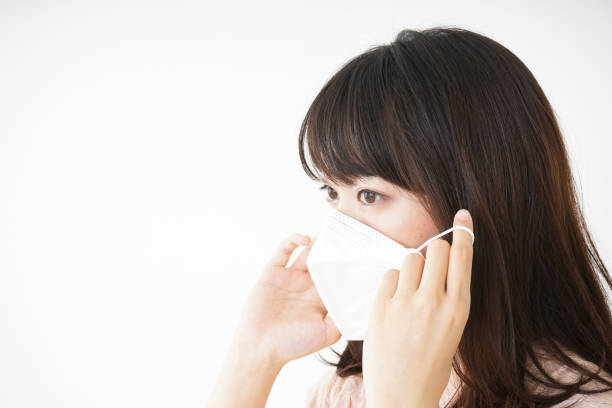 young woman wearing a mask - protective mask workwear stock pictures, royalty-free photos & images