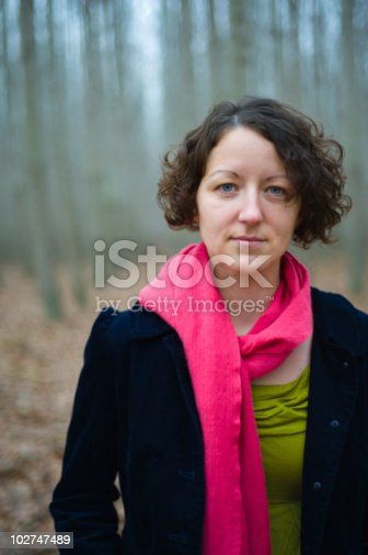 istock Young woman wearing a pink scarf 102747489