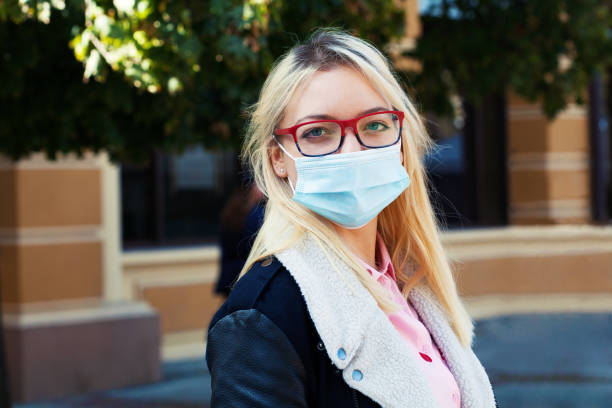 Young woman wearing a protective face mask stock photo