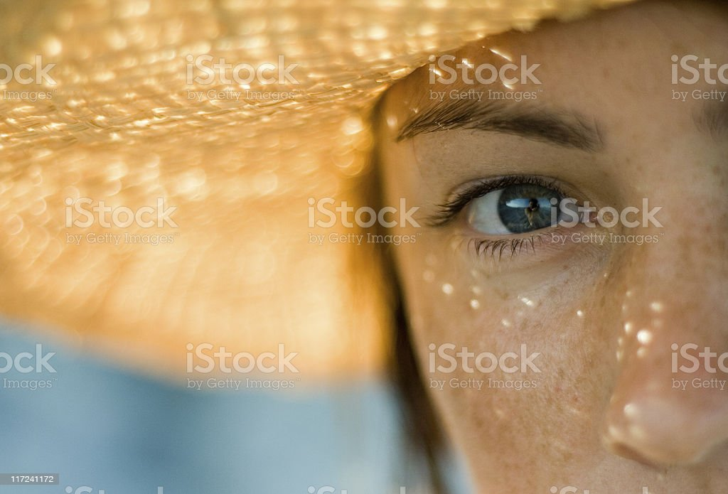 A young woman wearing a sunhat stock photo