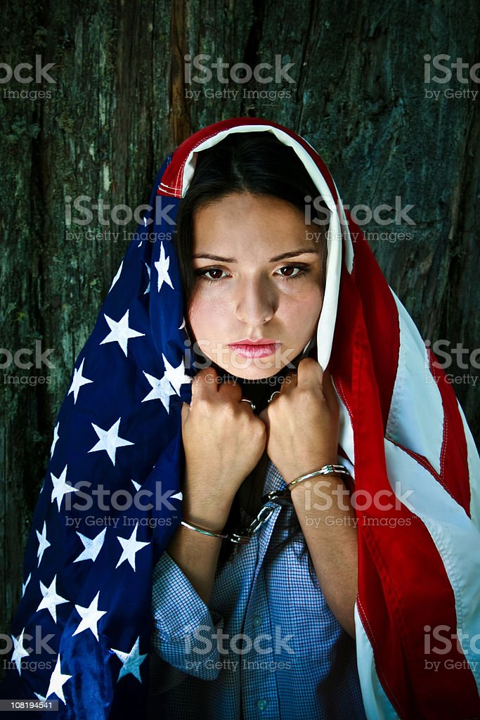 Young Woman Wearing American Flag and Handcuffs stock photo