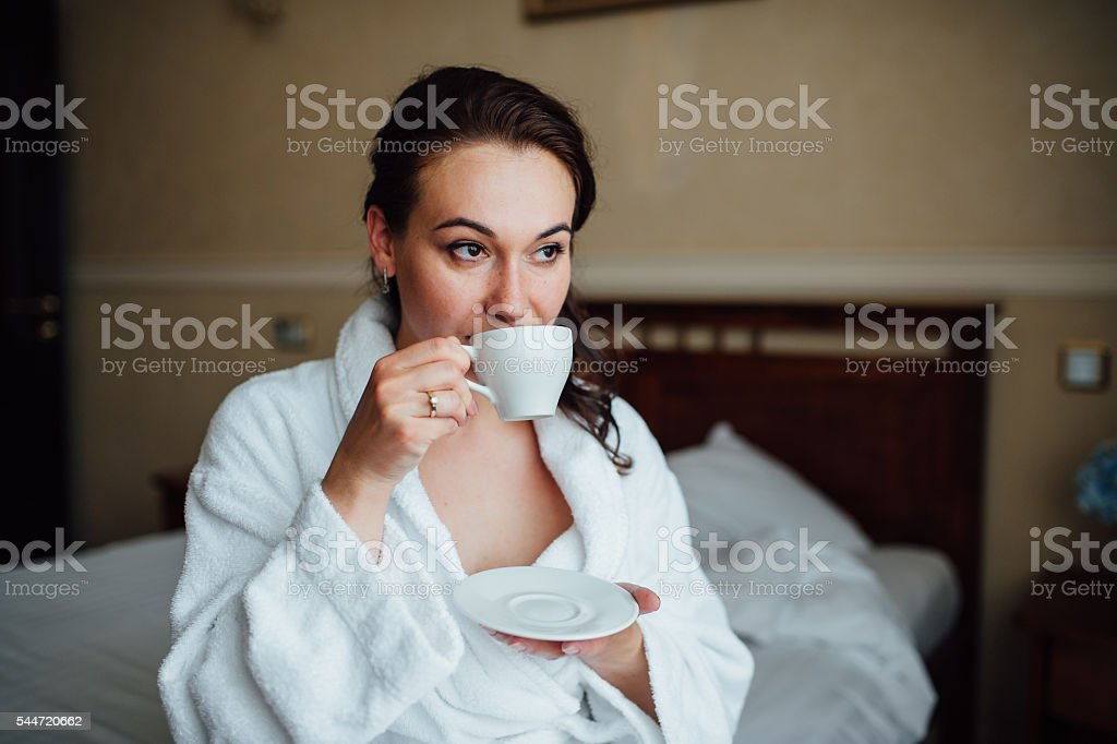 young woman wearing bath gown stock photo