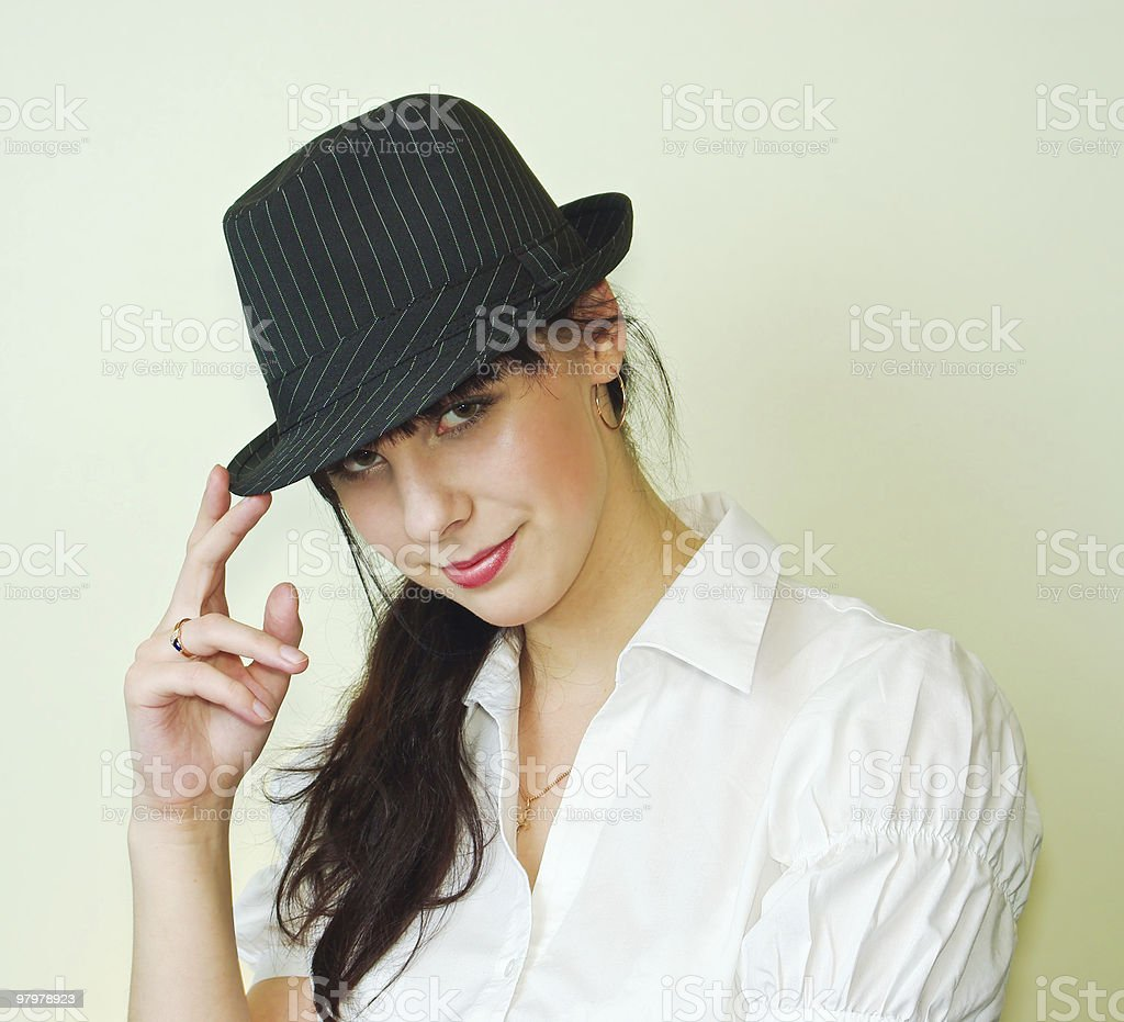 Young woman wearing black hat royalty-free stock photo