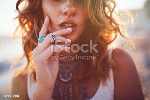istock Young woman wearing bohemian style silver jewelry 912270350
