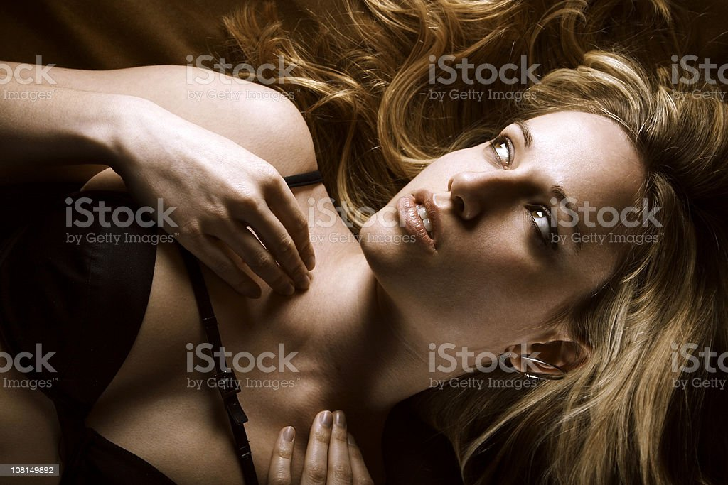 Young Woman Wearing Bra and Lying Down royalty-free stock photo