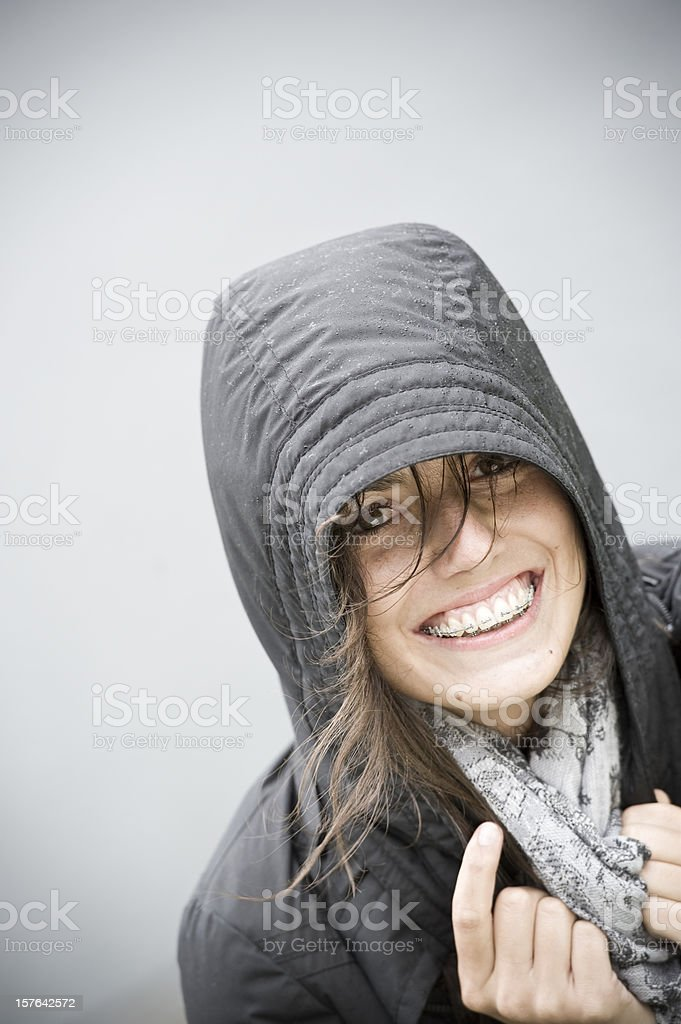 young woman wearing braces, outdoor portrait on a rainy day royalty-free stock photo