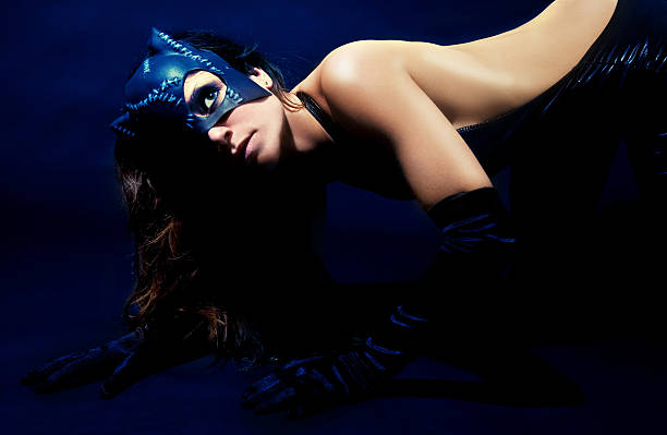Young Woman Wearing Cat Mask and Costume stock photo