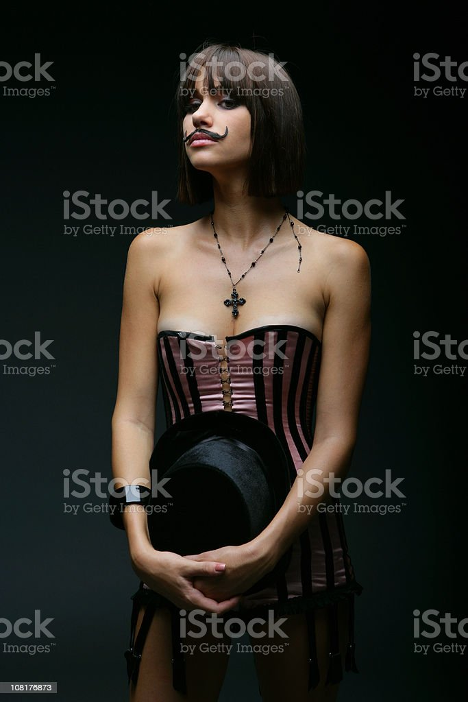 Young Woman Wearing Corset and Fake Mustache stock photo