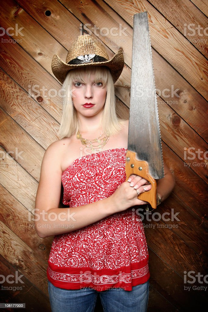 Young Woman Wearing Cowboy Hat Holding A Saw Stock Photo   More ... 607402f34418