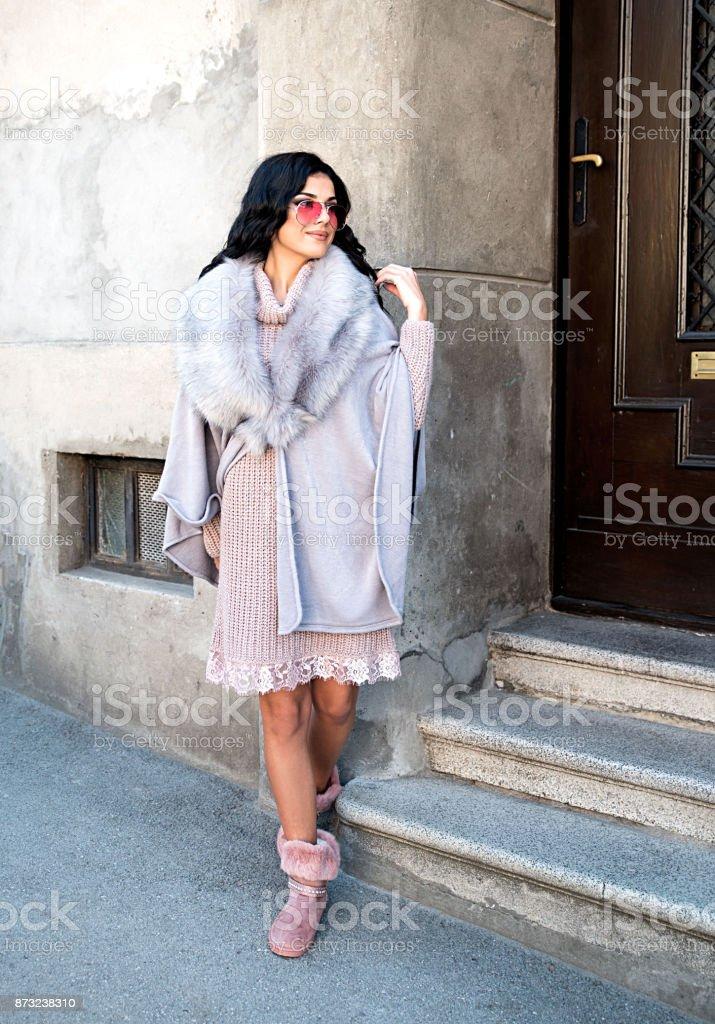 Young woman wearing elegant dress adn vest stock photo
