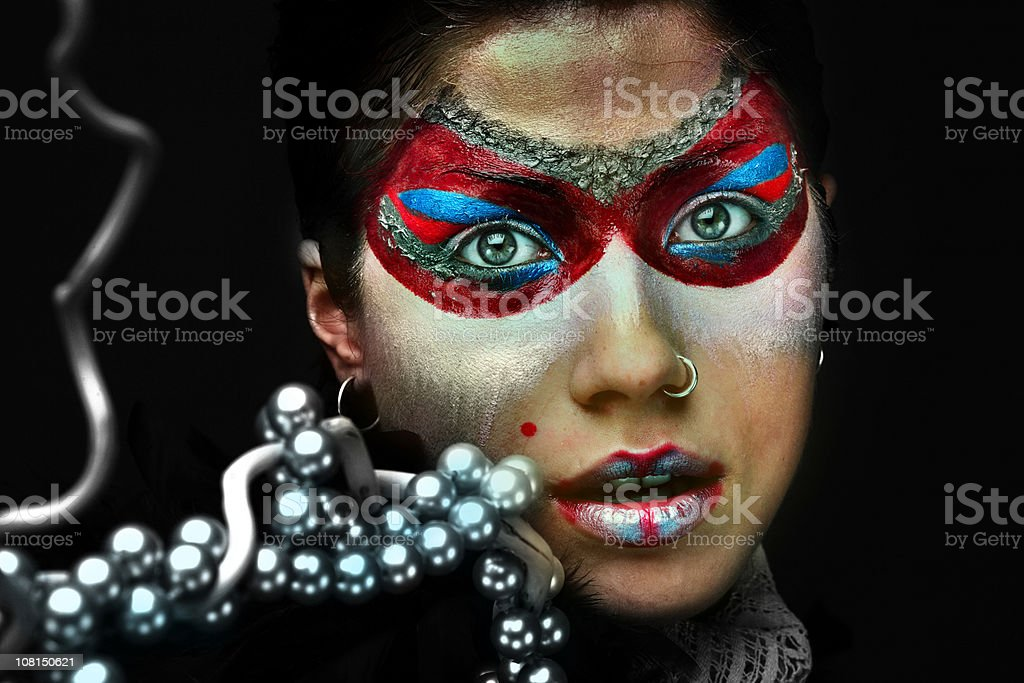 Young Woman Wearing Face Paint Make-Up and Beads royalty-free stock photo