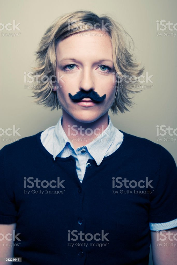 Young Woman Wearing Fake Moustache royalty-free stock photo