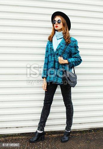 istock young woman wearing fashion black hat checkered coat jacket handbag 618195992