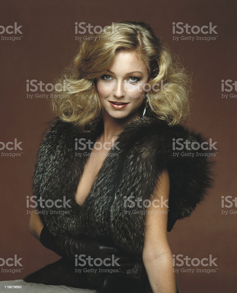 Young woman wearing fur clothes, smiling, portrait stock photo