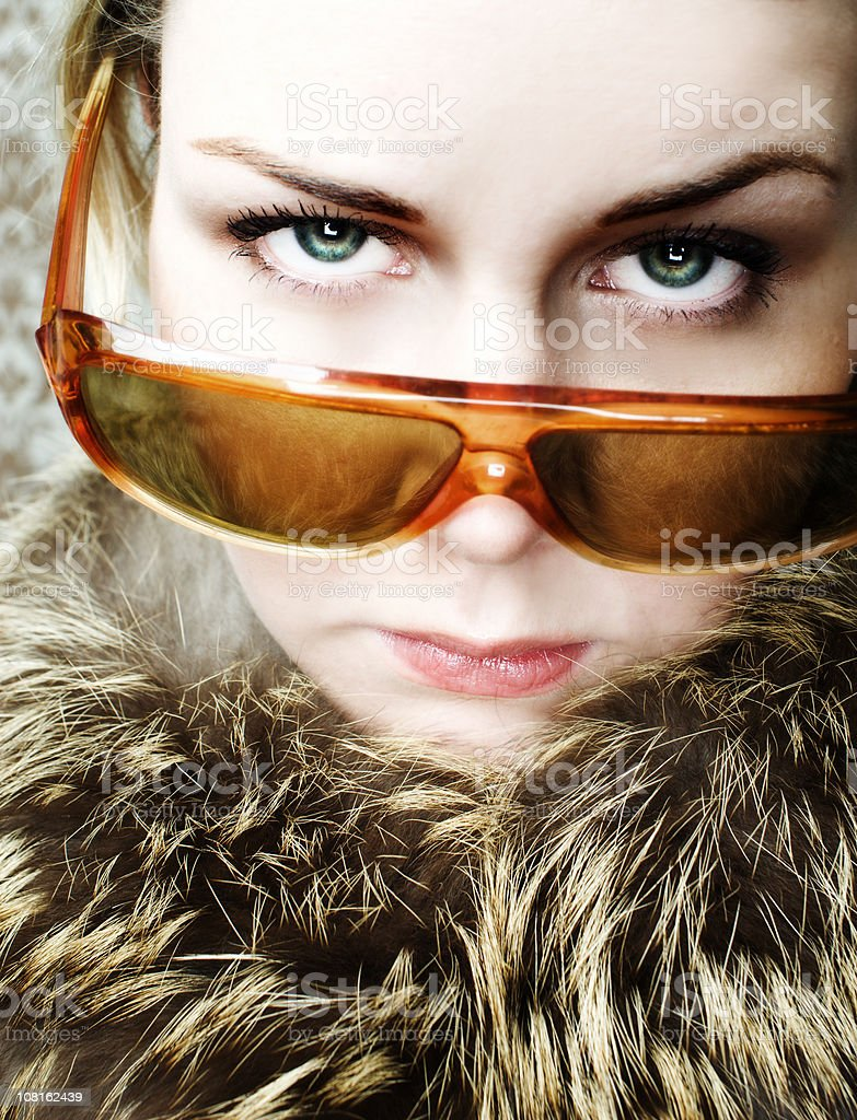 Young Woman Wearing Fur Collar and Sunglasses royalty-free stock photo