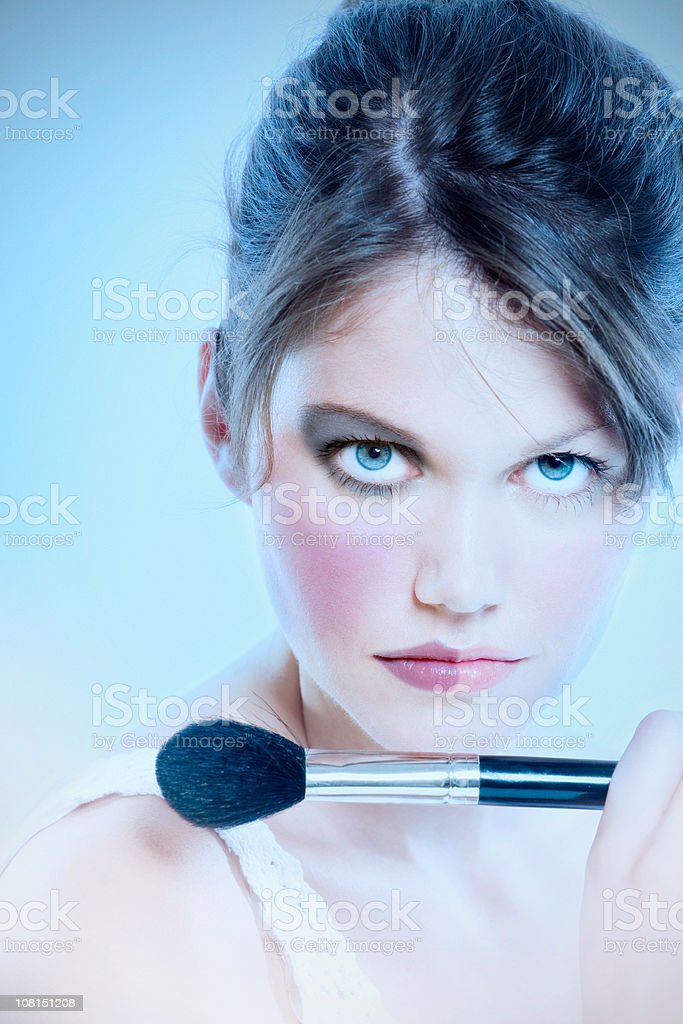 Young Woman Wearing Half Finished Make-up royalty-free stock photo