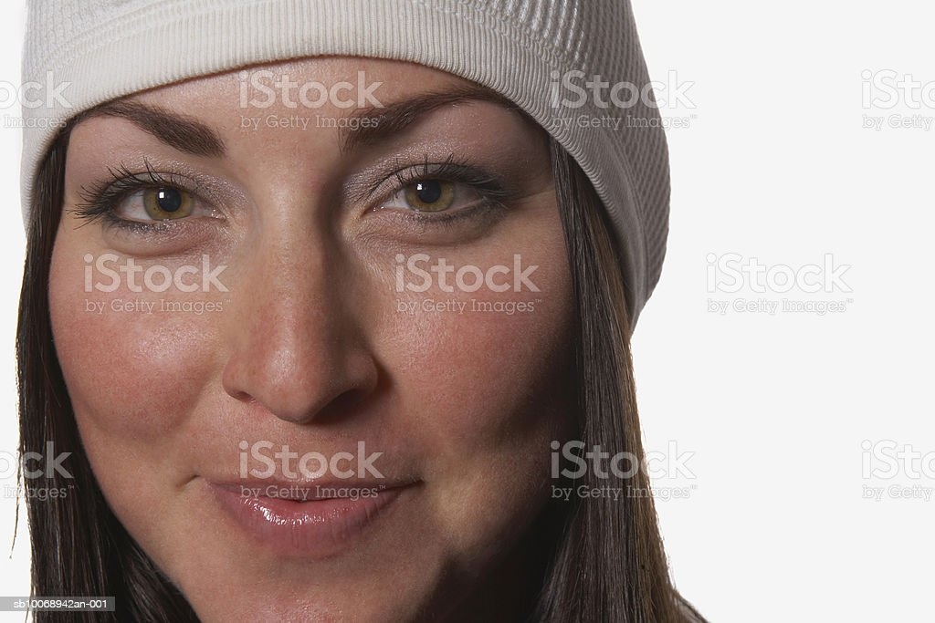 Young woman wearing hat, smiling, portrait royalty-free 스톡 사진