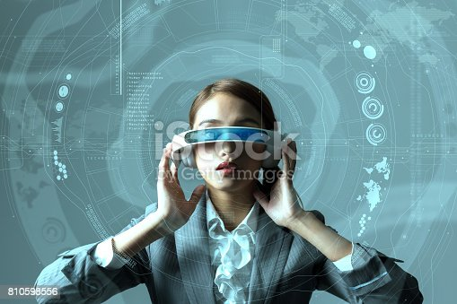 872677426 istock photo young woman wearing head mount display and futuristic GUI, smart glasses, graphical user interface, heads up display, Internet of Things 810598556