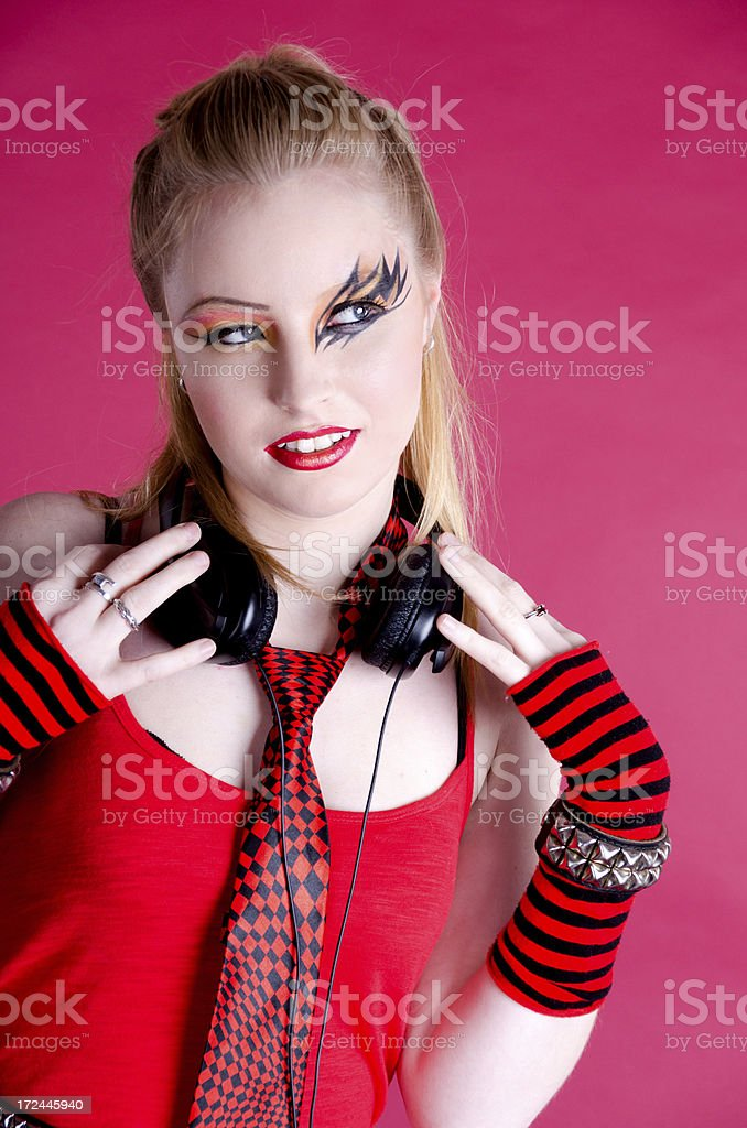 Young woman wearing headphones around neck, looking away. royalty-free stock photo