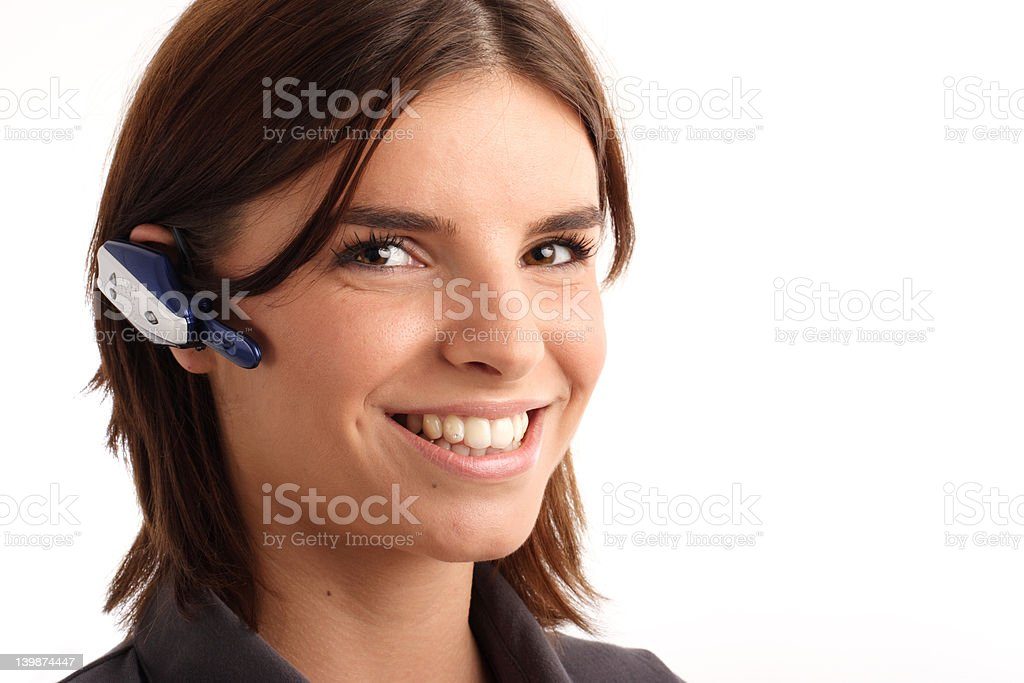 Young woman wearing headset (bluetooth) royalty-free stock photo