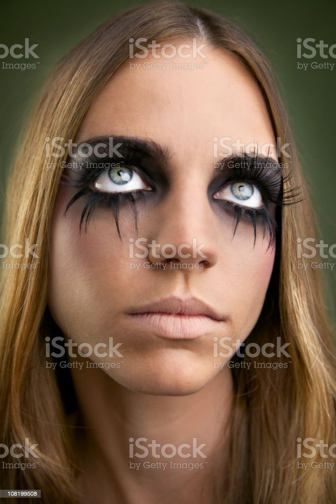 Young Woman Wearing Long Fake Eyelashes Posing royalty-free stock photo
